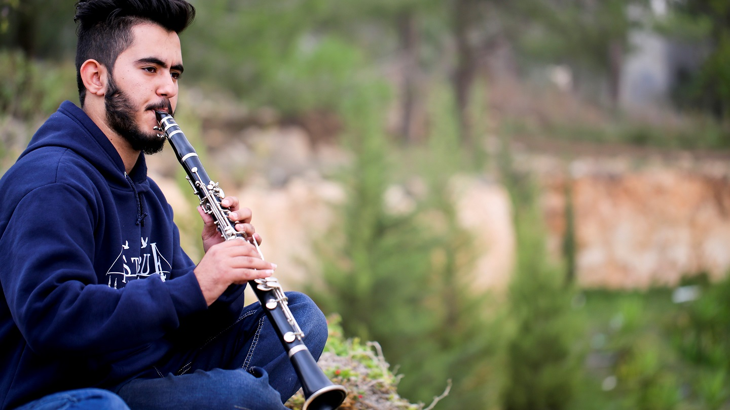 Palestinian student playing clarinet