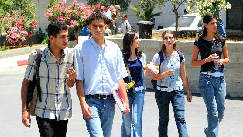 Palestinian students walking through campus